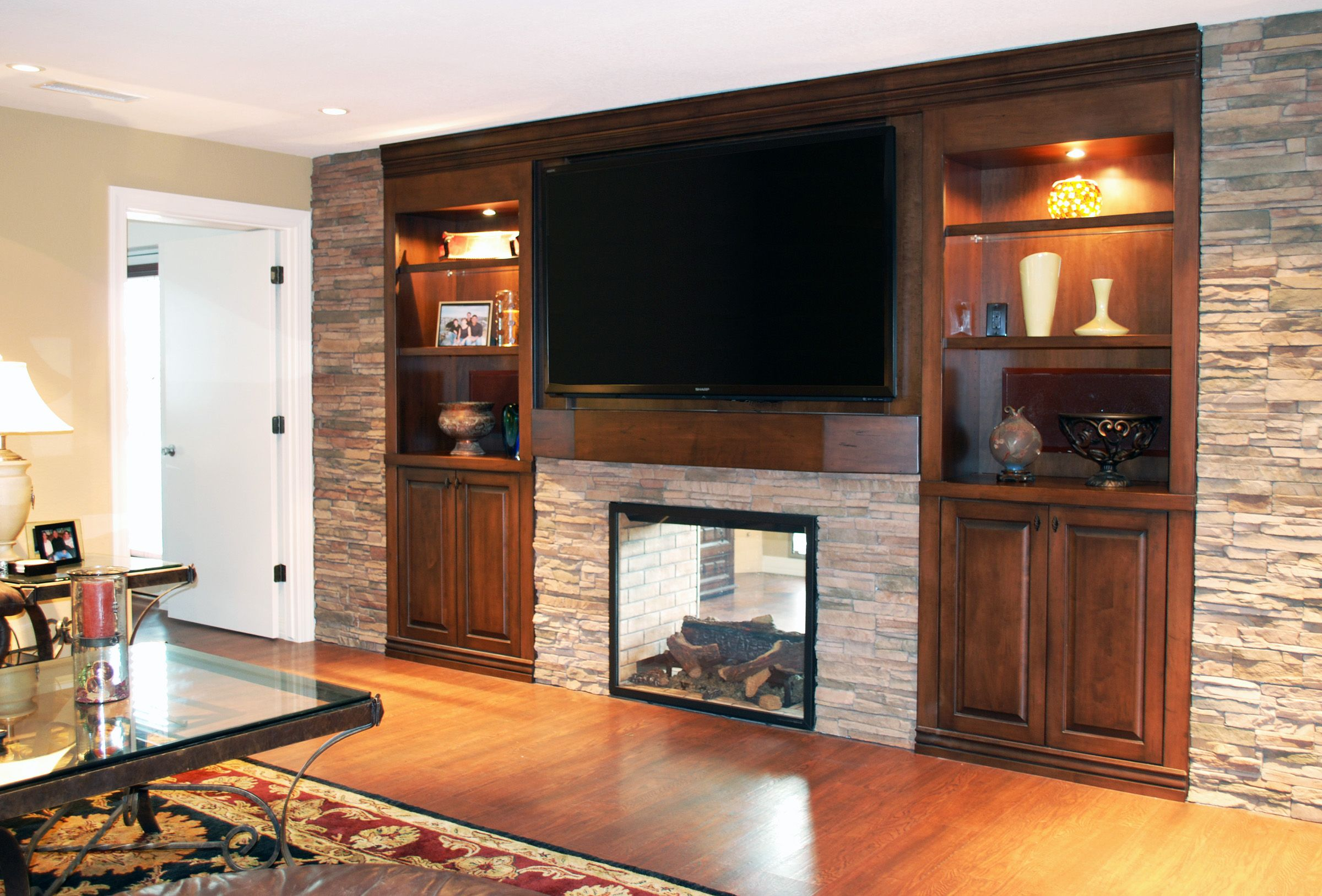 Favored Brown Wooden Fireplace Entertainment Center With Stacked Stones Wall Exposed Also Gloss Wood Floors As
