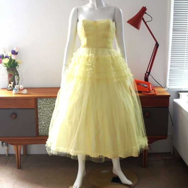 Vintage 50s pale yellow ruffled tulle prom dress with full skirt £110  http://www.pennydreadfulvintage.com/product/evening-dresses/1950s-pale-yellow-tulle-prom-dress/