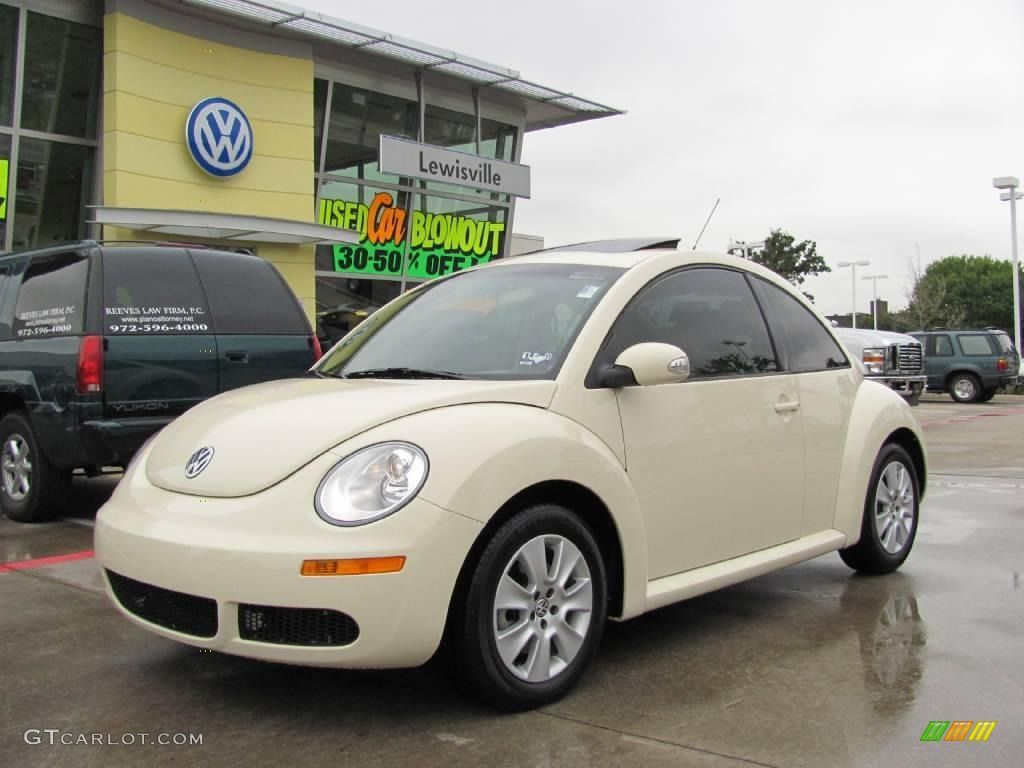 Cream colored volkswagen beetle