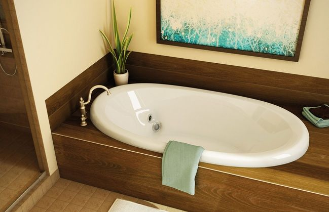 Bath tub with wood surround - cheap looking & too dark but this is ...