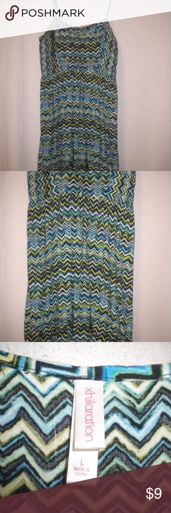 Xhilaratiion Juniiors Large Sundress Gently Worn. Xhilaration Juniors Size Large Sundress. Lined front chest. Adjustable spaghetti straps.  Zipper under the left arm.  Aqua, yellow, black, teal and white zig zag pattern. Made of 100% Rayon. Chest approximately 36 inches and length approximately 36 inches. Xhilaration Dresses