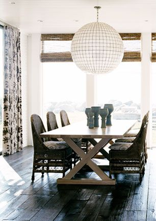 beach house dining room:  great ball chandelier; wood shades; wicker chairs + trestle table; distressed wood floors