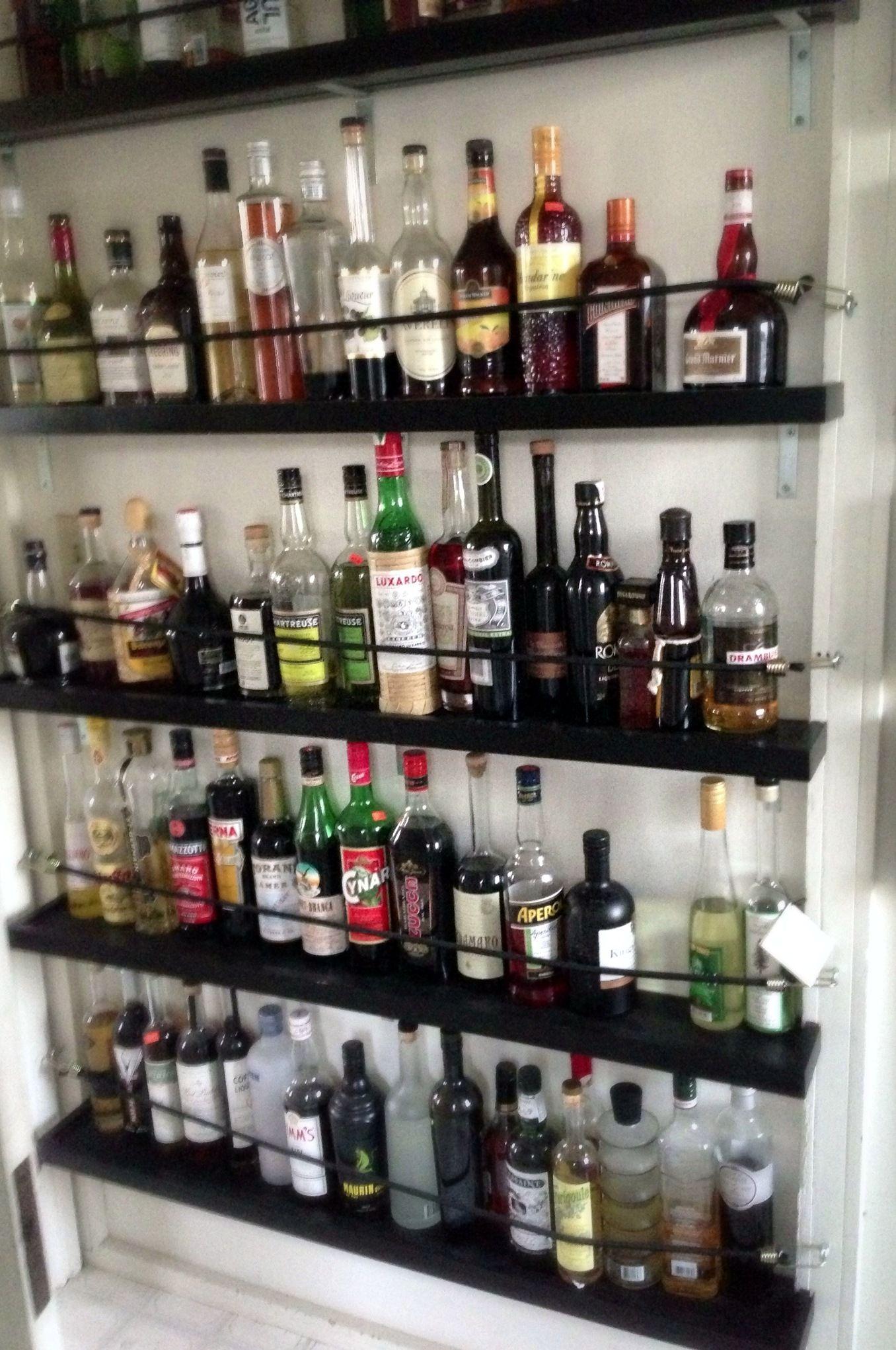 Shelving For Liquor Bottles Or How I Got My Drinking Problem Under Control The Drunken Botanist Liquor Shelf Bottle Display Bar Shelves