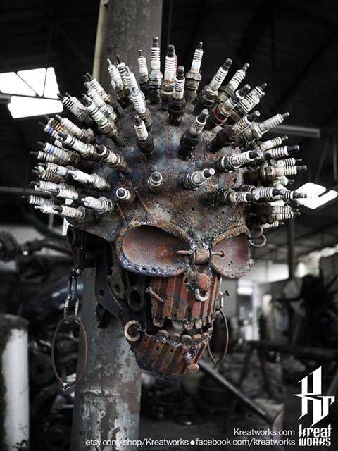 Custom Metal Sculpture With Spark Plugs All Over The Head.