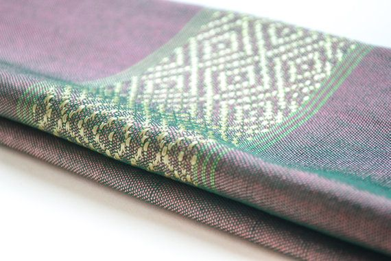 Handmade by artisanal weavers in Ethiopia using organic cotton, silk and traditional techniques Azola presents the Purple Green Two Tone Scarf. Let this