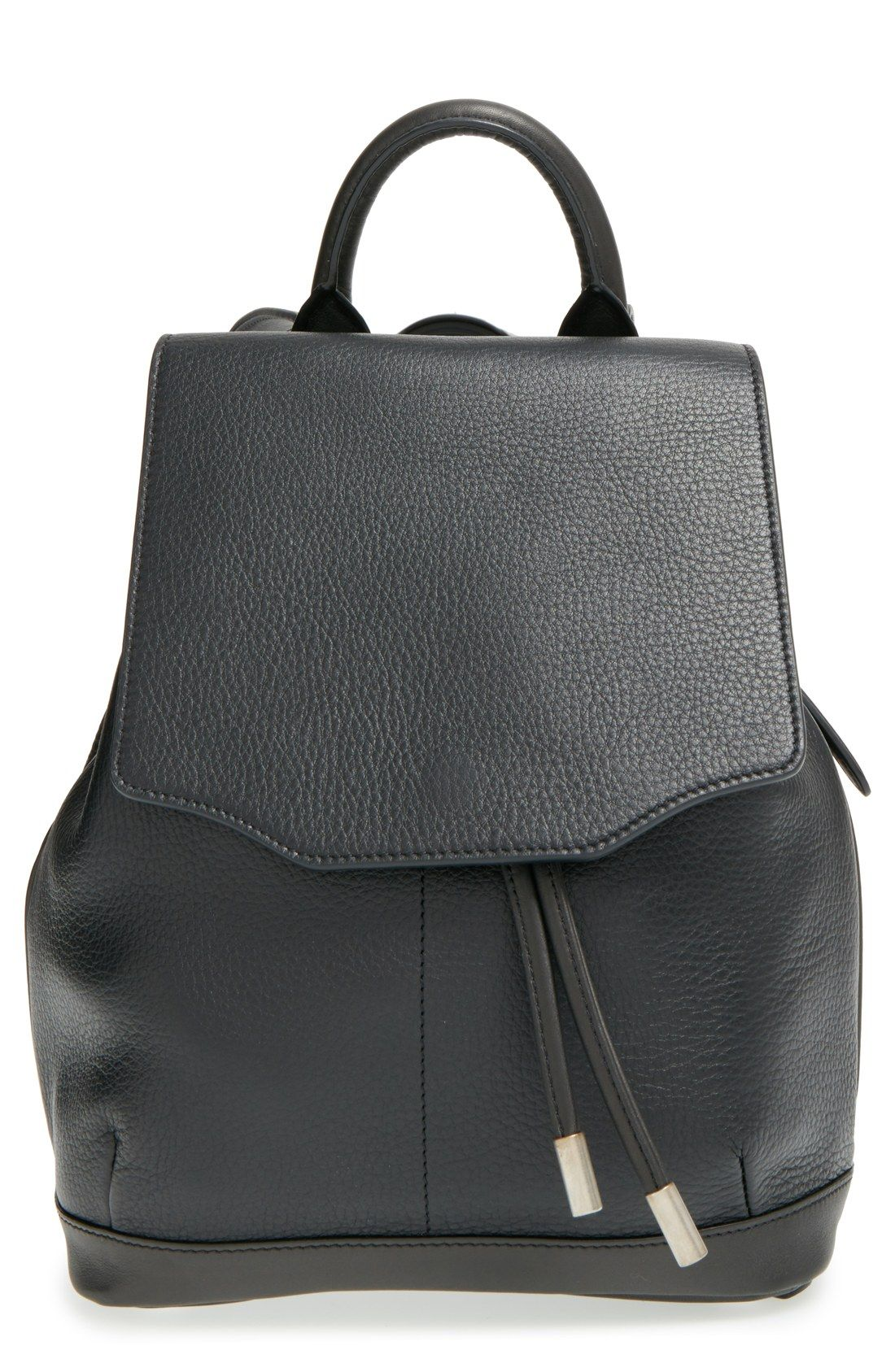 56aae82b07eb Elevating the street-style game with this rag   bone bucket bag-inspired  backpack.