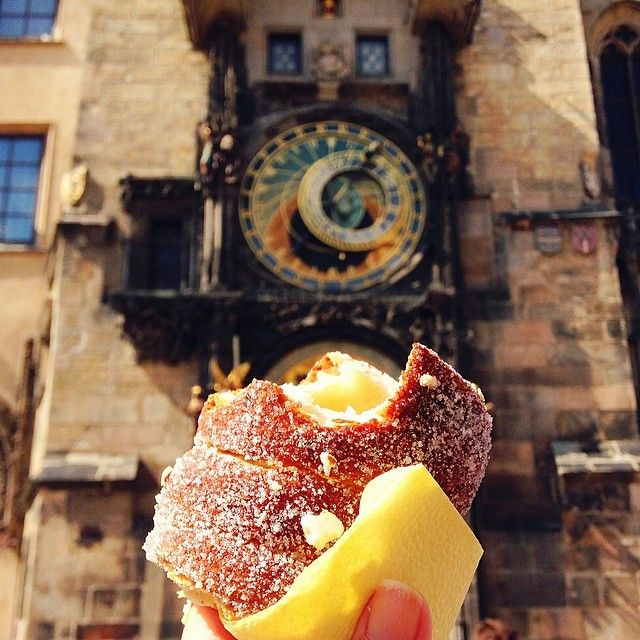 Trdelník in front of the Astronomical Clock in #Prague, which is possibly the most impressive clock I have ever seen