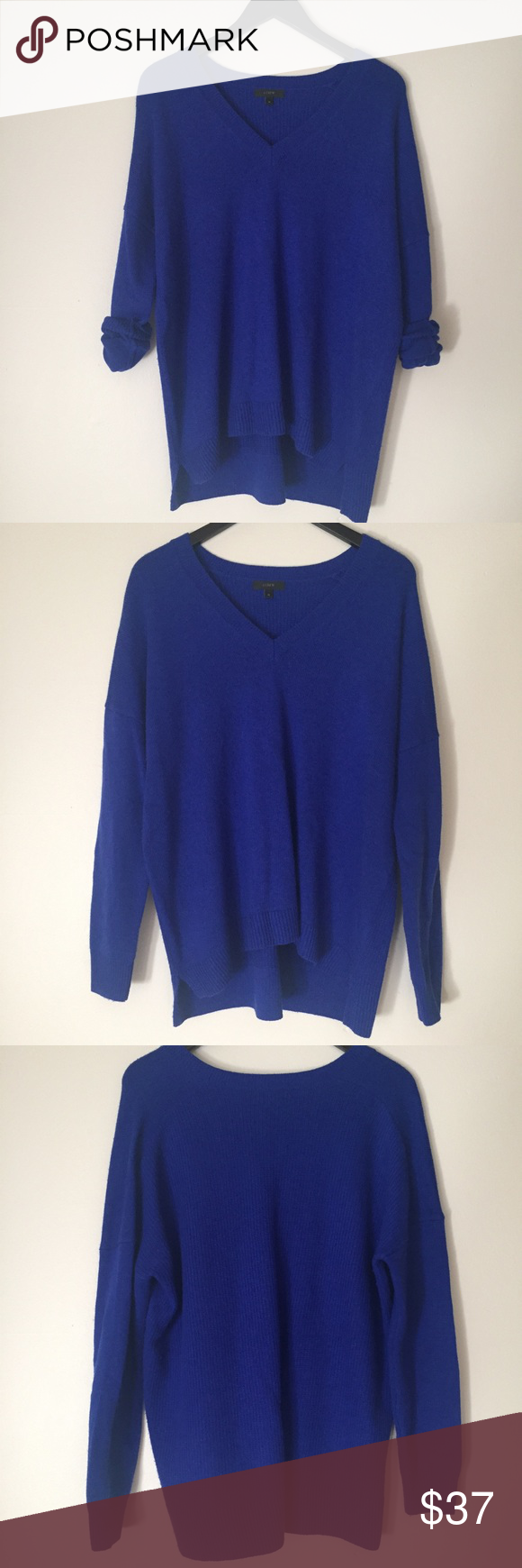 """J. Crew Bright Blue Wool Blend Oversized Sweater J. Crew Bright cobalt blue oversized sweater! Size medium. V-neck and long sleeves. Front 25 1/2"""" long, back 27 1/2"""" long, 24 1/4"""" pit to pit, sleeves 16 3/4"""" long, v-neck 7"""" deep. Back is Ribbed texture. 40% wool, 35% nylon, 25% viscose. Good condition- minor wear/pilling. Does have minor fuzz from Wool Blend. NO TRADES. J. Crew Sweaters"""