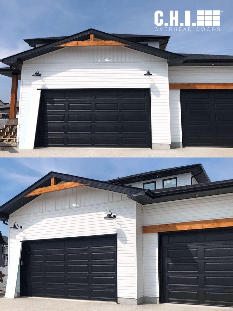 Black Raised Panel Garage Doors On Modern Farmhouse Exterior Black White And Wood In 2020 Black House Exterior Modern Farmhouse Exterior White Exterior Houses