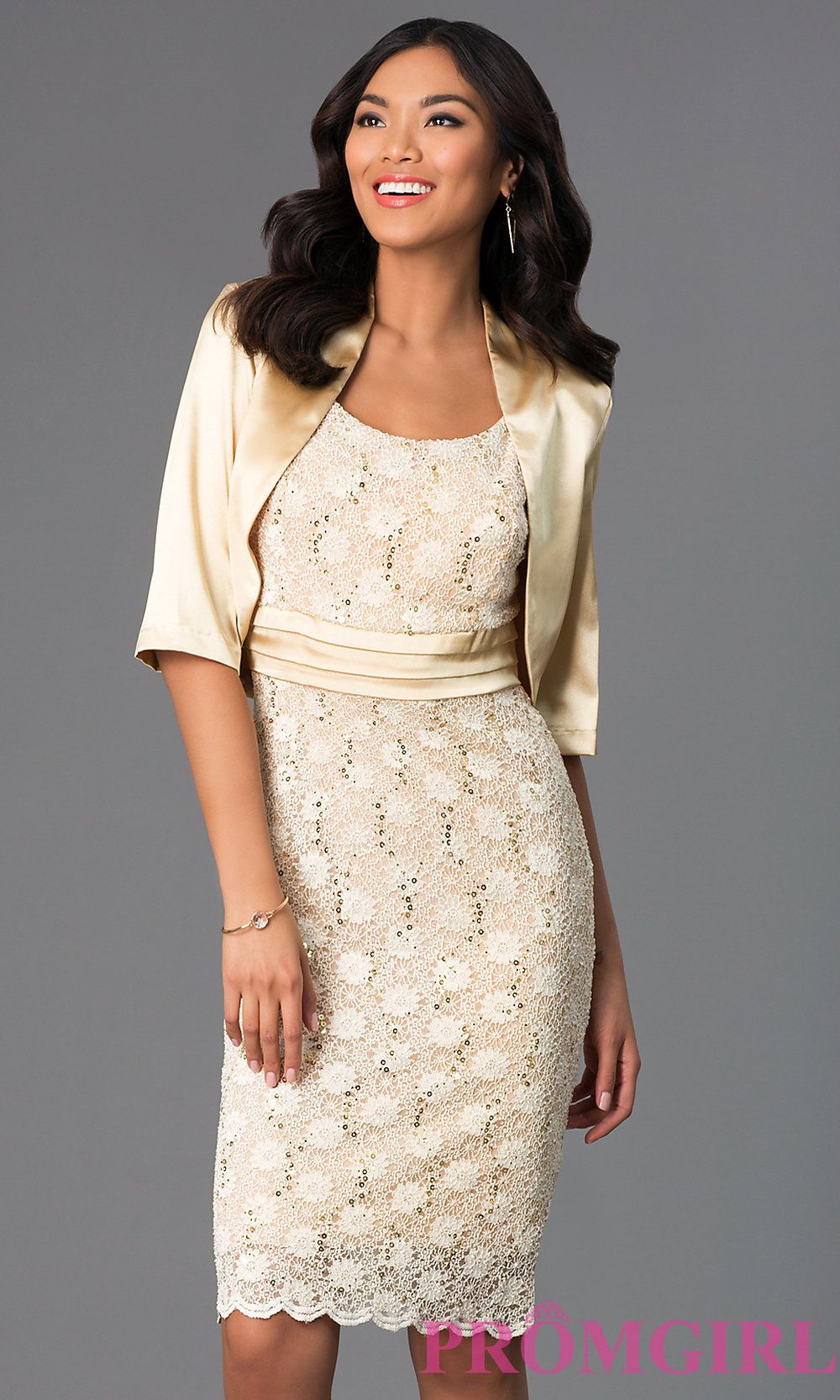 Image of knee-length lace dress with matching bolero. Front Image