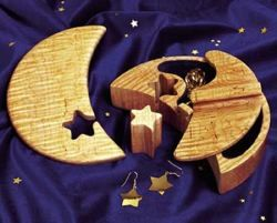 If you have promised the moon and the stars, this cleverly designed jewelry box will rise to the occasion. The sliding lid unlocks when you pull out the star. Inside, another lid conceals flocked secr...