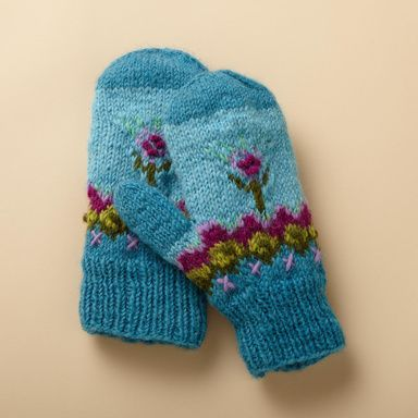 Village workshops in Kathmandu hand knit our snug little mittens accented with bright bobbles and embroidery. New Zealand wool, lined with polyester fleece. Hand wash. Exclusive. One size fits most adults.