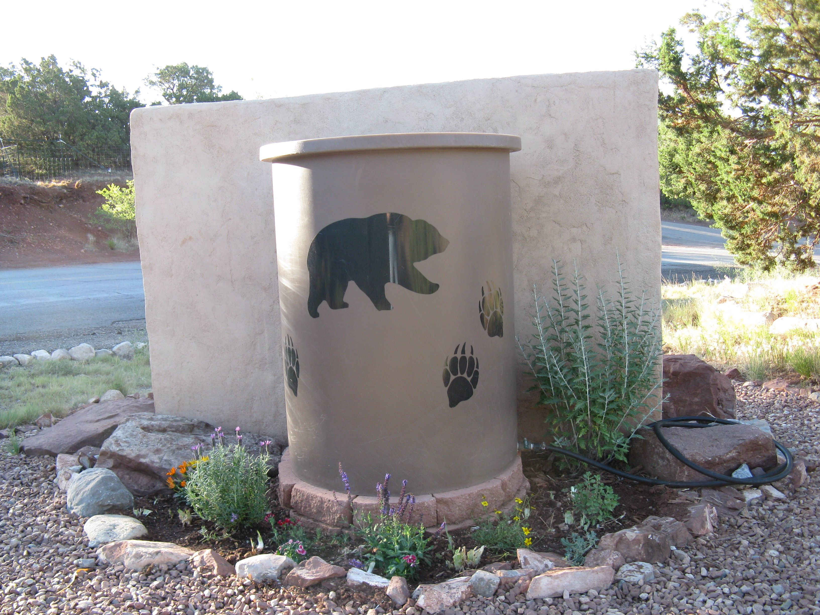 This Remote Tank Manufactured By Desert Plastics Is In A Great Location The Water Captured Can Be Used To Care For Water Barrel Rain Water Barrel Rain Barrel