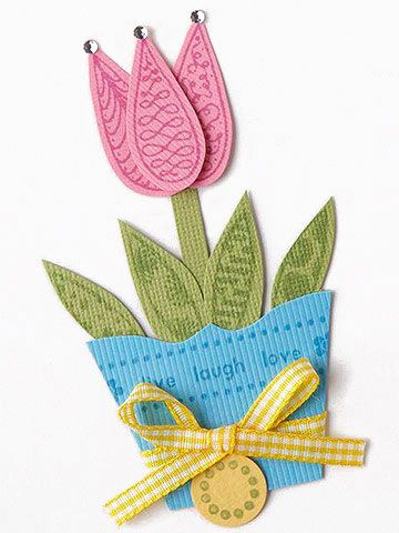 Design by Valerie Salmon Add ribbon, gems, or other embellishments to your stamped piecings for a fun look. Valerie's stamps form most of the decoration, but the subtle additions of a ribbon around the flowerpot and gems on the petals complete the adorable accents.