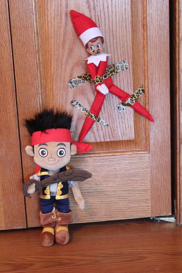 Elf taken hostage + lots of other elf on the shelf ideas #elfontheshelf