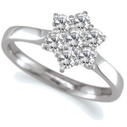 £860.00. Platinum diamond cluster ring, set with 0.33cts of round brilliant cut diamonds in an elegant daisy style cluster. Size M.
