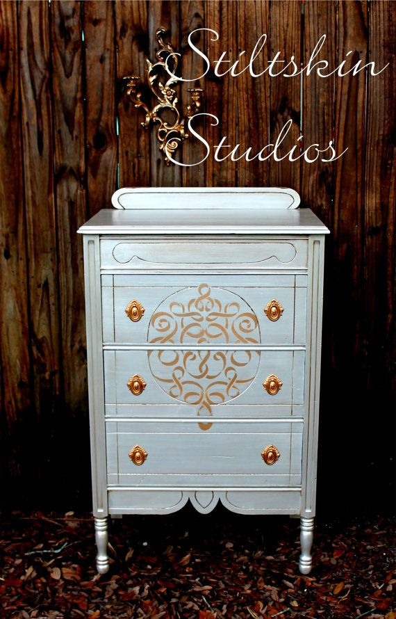 The Ribbon Damask Stencil on a gorgeous antique walnut tallboy in a pearlized silver metallic | By Stiltskin Studios