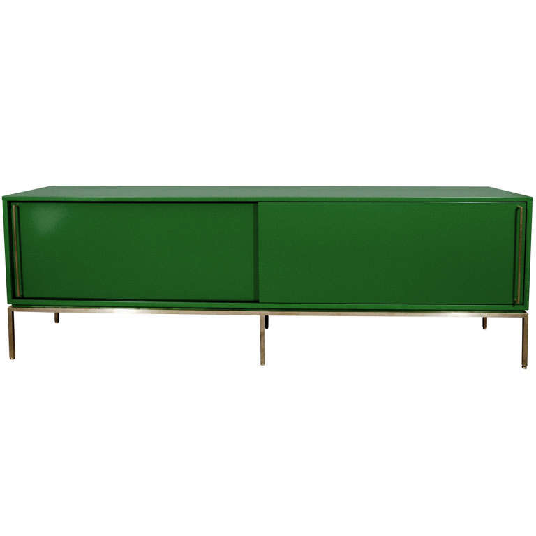 Green lacquered sliding door credenza on satin brass base | From a unique collection of antique and modern credenzas at https://www.1stdibs.com/furniture/storage-case-pieces/credenzas/