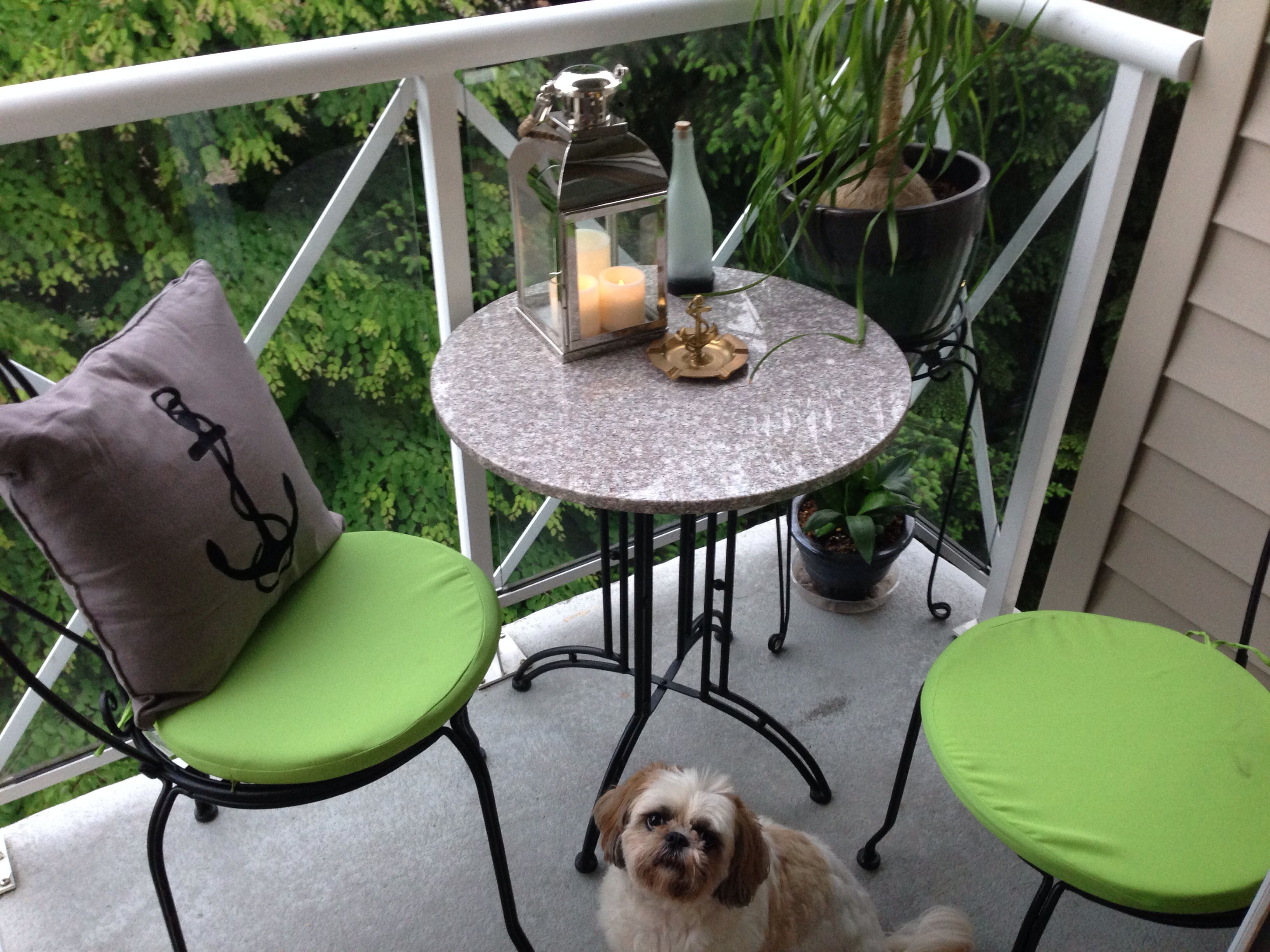 My cozy little patio! I added a lantern with LED candles ...