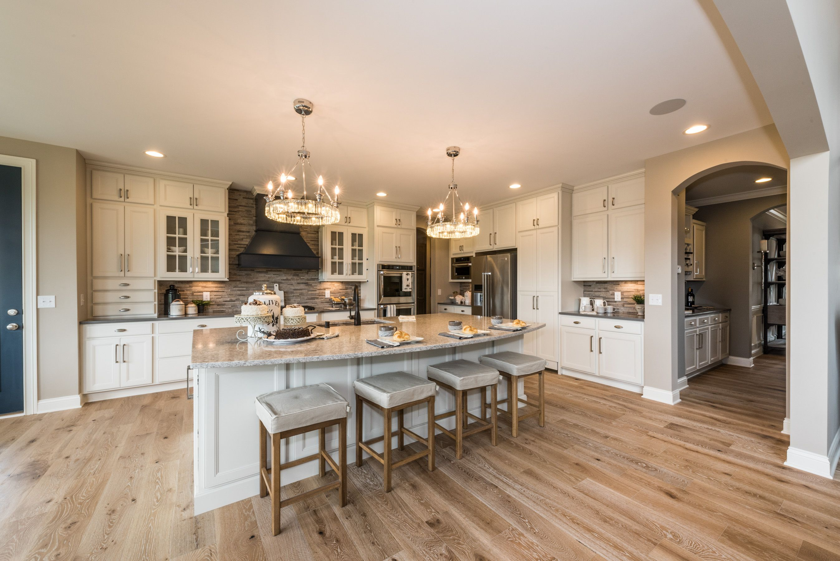 This Stunning Kitchen Features Floor To Ceiling White Cabinets, A