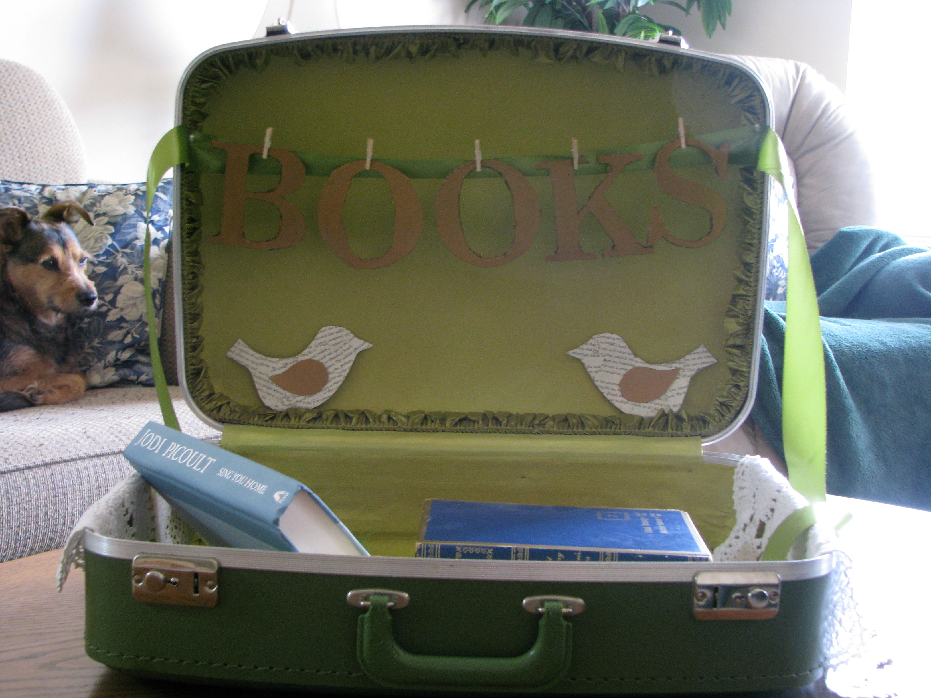 just finished my vintage suitcase book holder for noah s baby