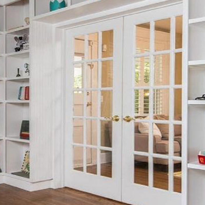 Swinging French Doors With Glass Panels Separating A Library From A Living Room French Doors Bedroom French Doors Inside Installing French Doors