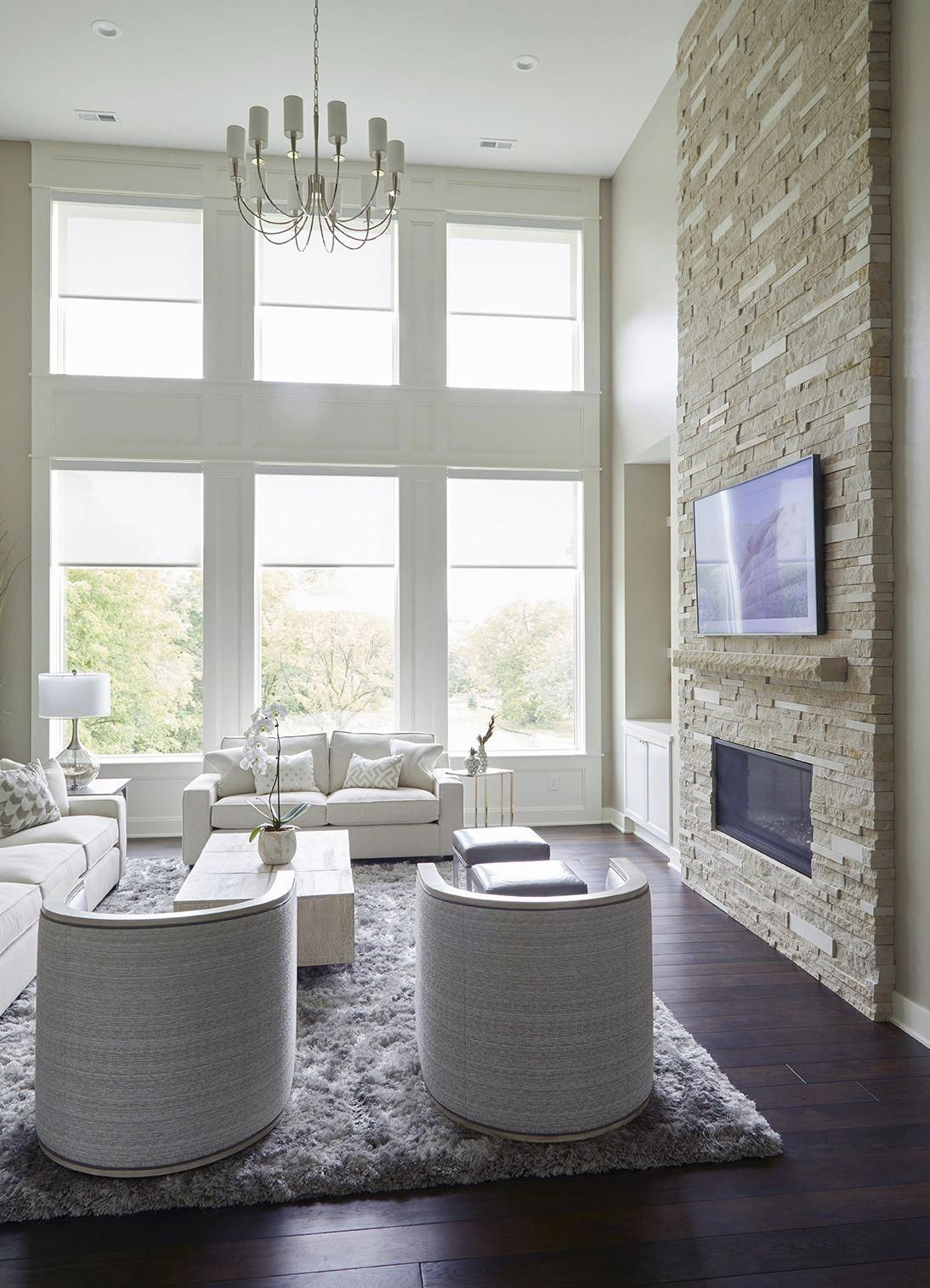 Transitional living room design with stacked stone fireplace and dark hickory floors by Jillian Lare Interior & Transitional living room design with stacked stone fireplace and ...