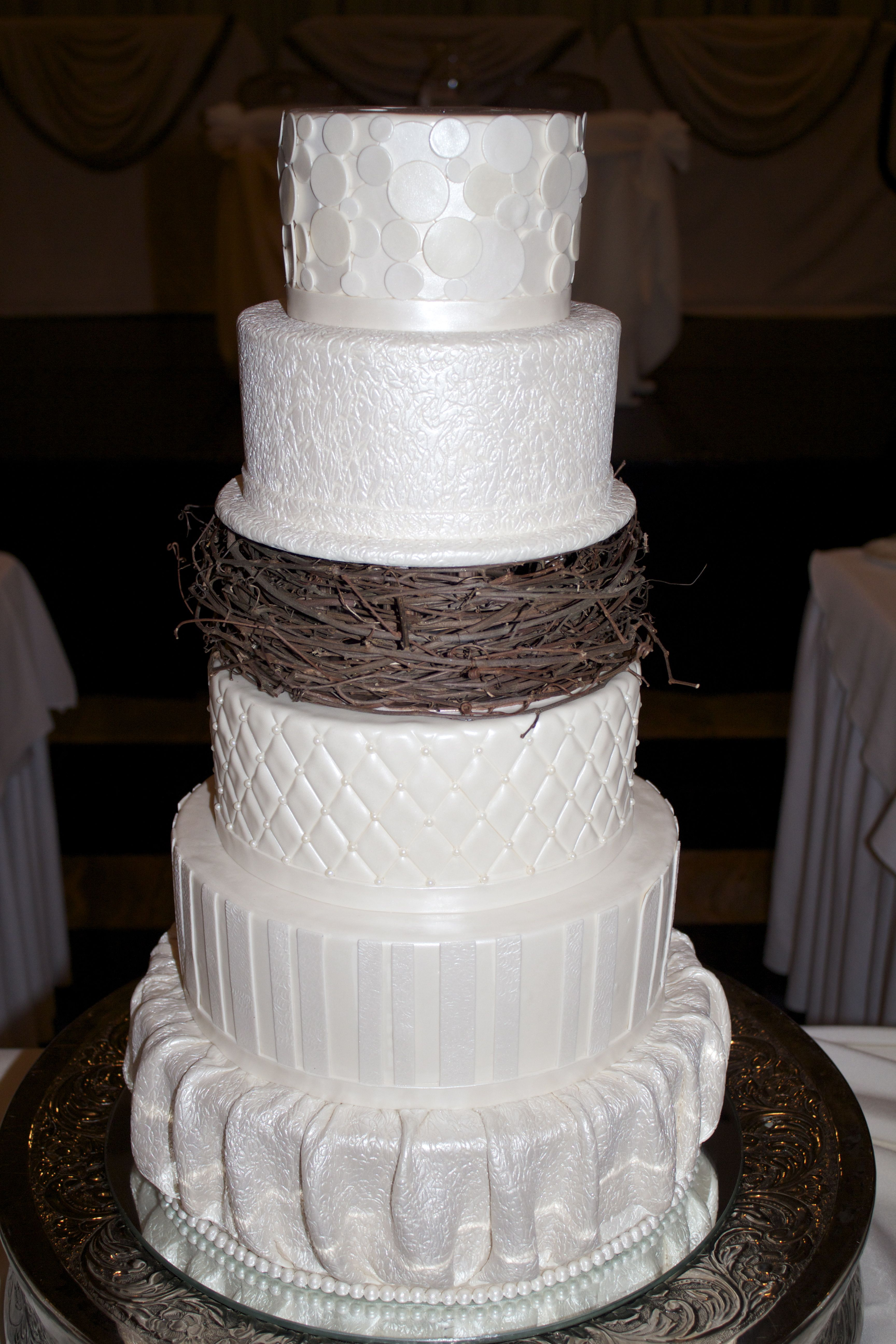 Tiered white wedding cake with a layer of a rustic nest. | Amazing ...