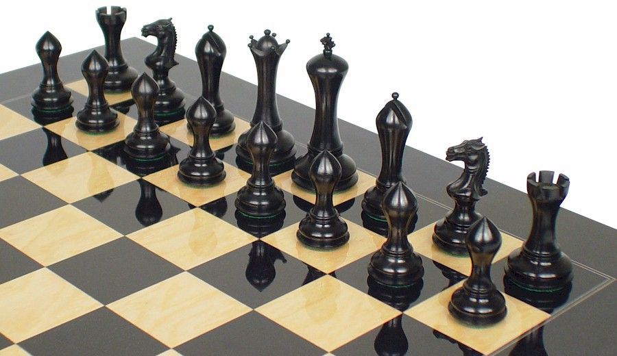 """Wow, 4.4"""" King, Luxury Gotham Staunton Chess Set, Ebony & Boxwood, unique features & lines best described as art deco. The pieces share elegant profiles with beautiful curves, simple shapes, retain a Staunton familiarity. Ebony is pure black, polished to a beautiful glossy shine & the beautifully grained boxwood in an ideal medium amber color. http://www.thegamesupply.com/luxurychesssets #artdecochessset #gothamstauntonchessset"""