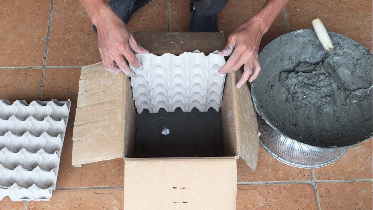 Cardboard boxes and egg trays creative cement pots