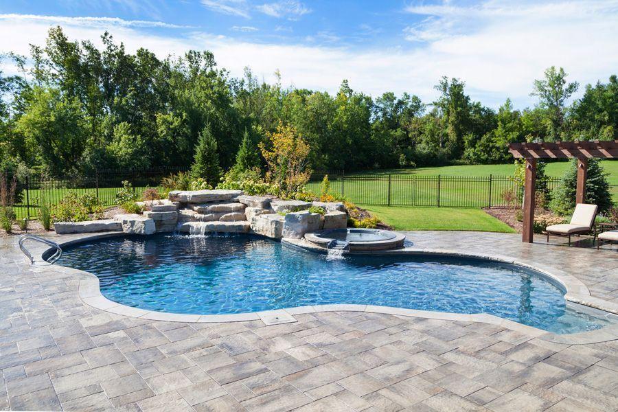 Lagoon Shaped Inground Pool With Full Black Onyx Liner Rock Waterfall Jump Rock Multi Coloured Pools Backyard Inground Inground Pool Designs Pool Waterfall