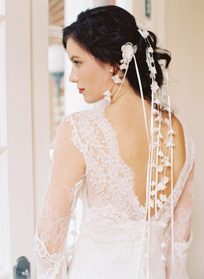 Forgo the traditional veil and instead opt for a cluster of these equally gorgeous lily of the valley veil pins. Pair these pins with a  twisted updo  for an easy-breezy bridal look.