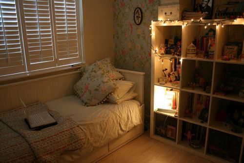 Matching wallpaper and throw pillows Strings of Christmas lights A