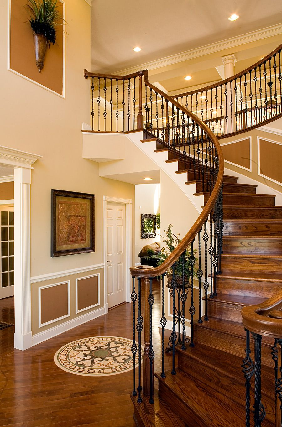 Beautiful curved staircase by angelique iron spindle staircase iron staircase railing