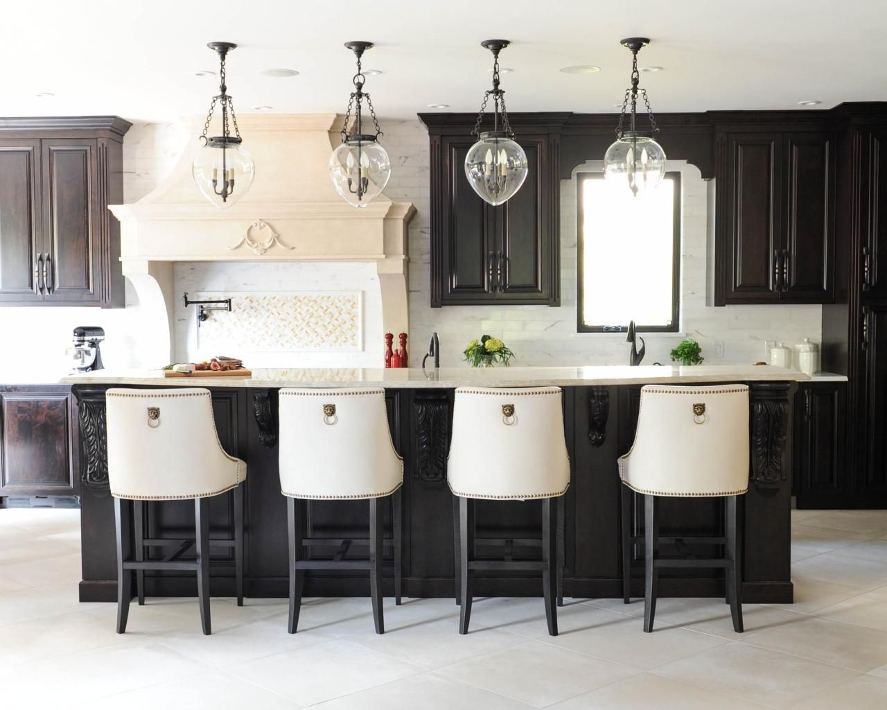 Four Glass Pendants Provide Task Lighting Above A Spacious Two Tiered Island In This Custom
