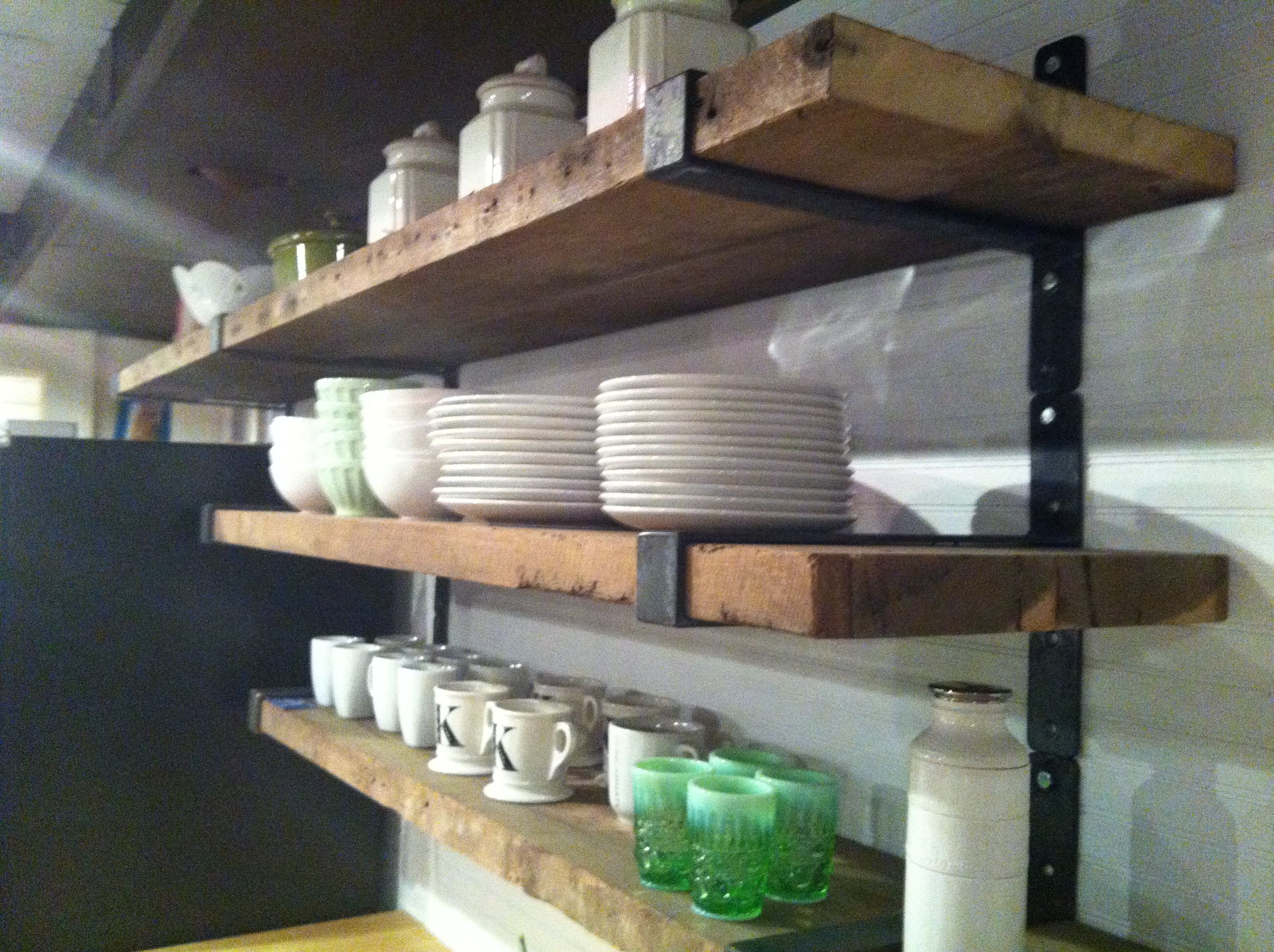 rustic wood shelves with metal straps like this with all white