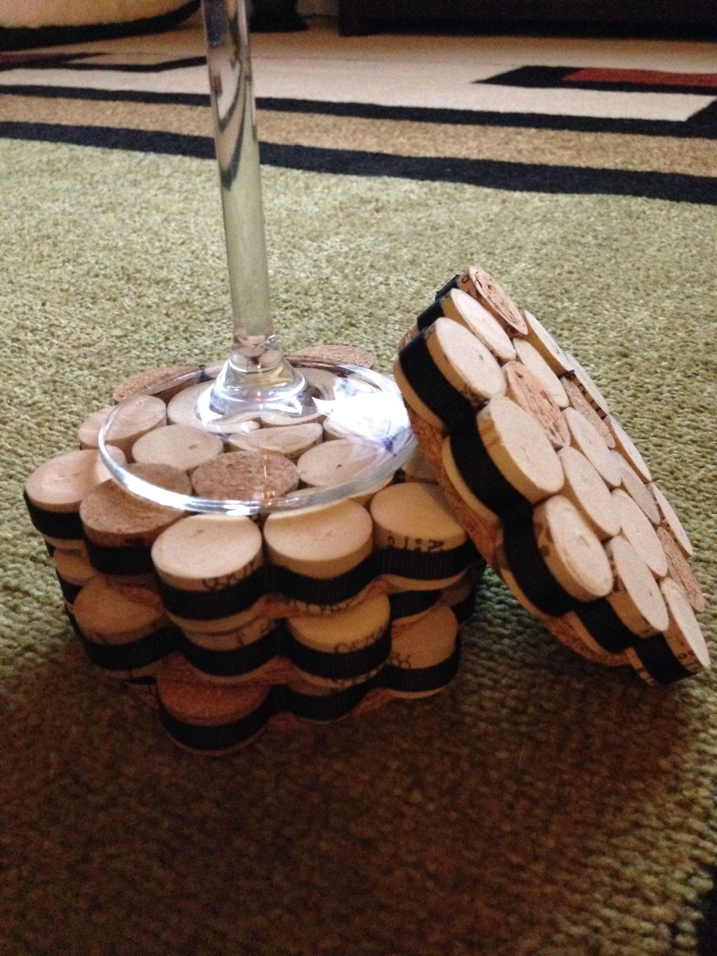 My DIY wine cork coasters.  Why buy them when you can make them yourself?  All you need is wine corks (about 26, but count in a few extras for mess ups), cut evenly into thirds, flat cork rounds, tacky glue, ribbon, and plenty of patience.
