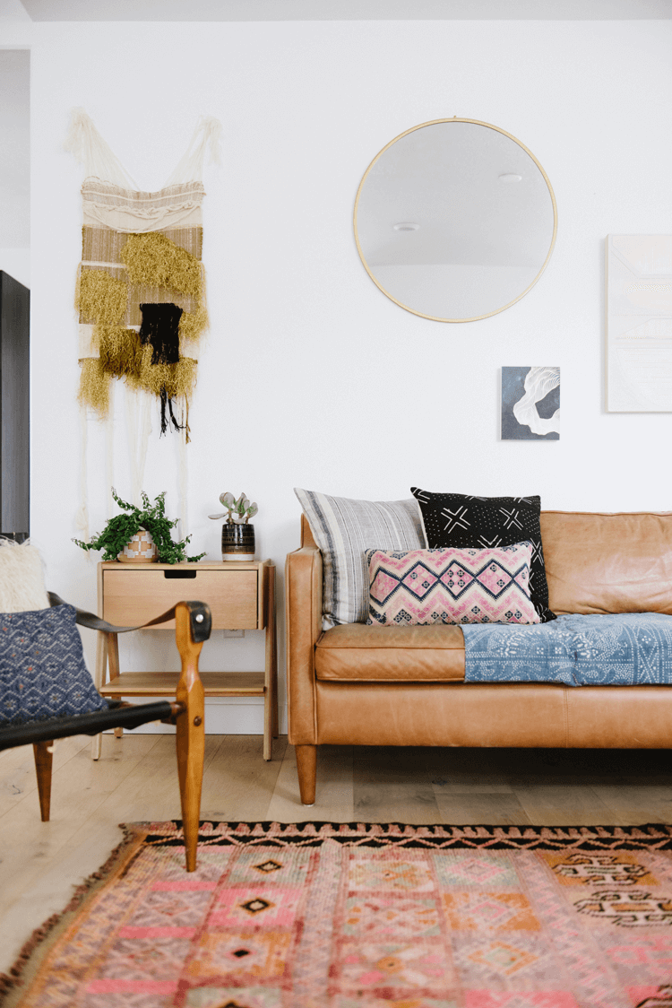 A Modern Boho Living Room With Vintage Rugs And A Safari Chair Concepts And Colorways Modern Boho Living Room Leather Couches Living Room Leather Sofa Living Room #tan #rugs #for #living #room