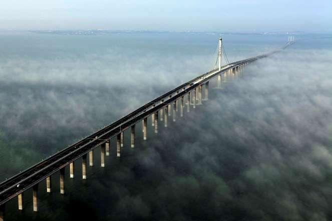 China's amazing engineering marvels. Jiaozhou Bay Bridge - worlds longest cross-sea bridge. 42 kms, 6 lanes. 2.3 billion, a decade to complete. Yan Runbo/AP Photo