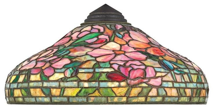 <b>Tiffany Studios Favrile Leaded Glass Spring Peony Shade  </b> <br /> First quarter of the 20th century <br /> Of domed shape, decorated with striated and mottled pink, plum, amethyst and blue tinted blossoms against a mottled green ground, tag stamped <i>TIFFANY STUDIOS NEW YORK. Height 7 1/2 inches, diameter 18 1/4 inches.</i> <br />  <br /> C