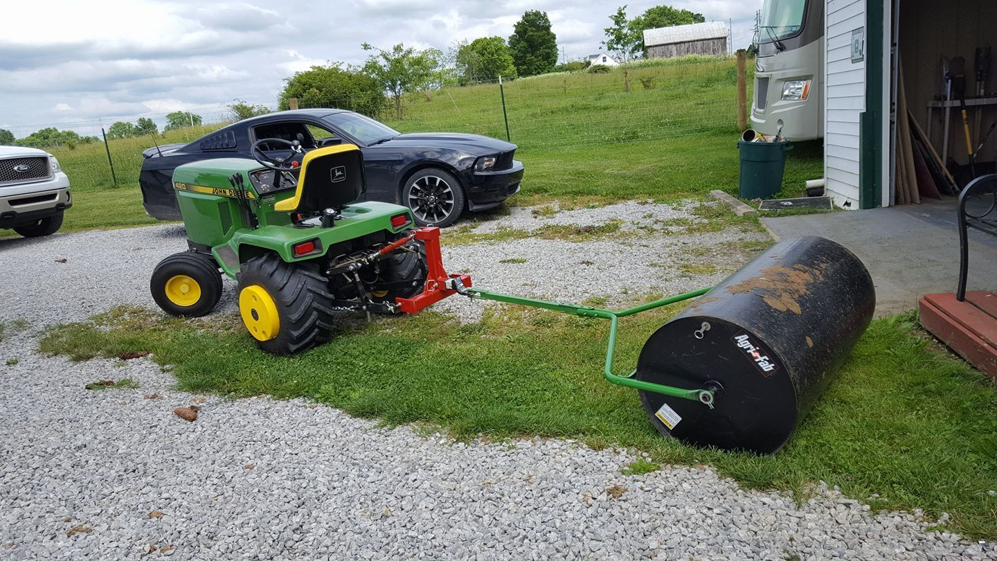 John Deere 420 Garden Tractor With Lawn Roller. Credit: FB User