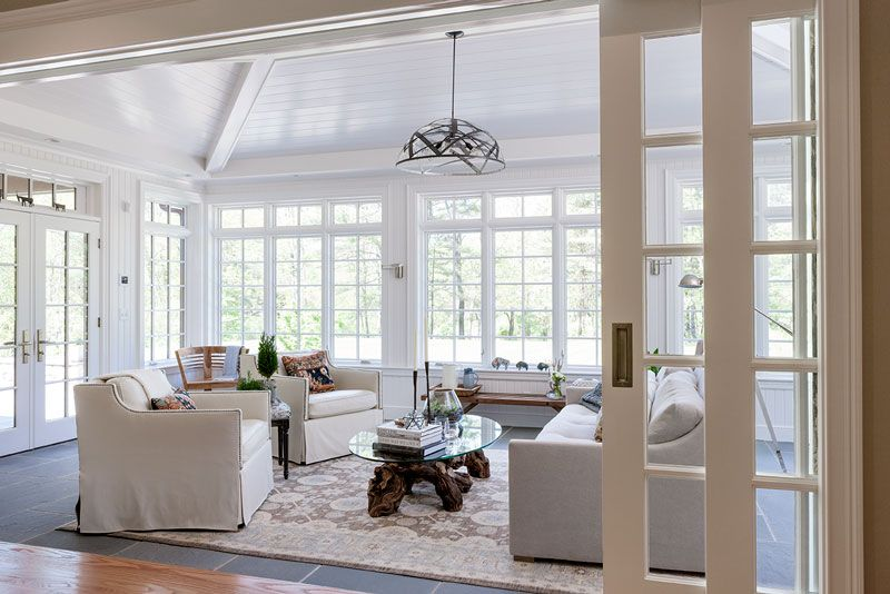Vaulted Ceiling Sunroom Tandem Pocket Wall Doors That Are 12 Feet Wide Easily Open And Shut
