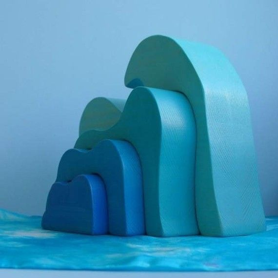 blue wooden toys to be payed with on wooden floorboards