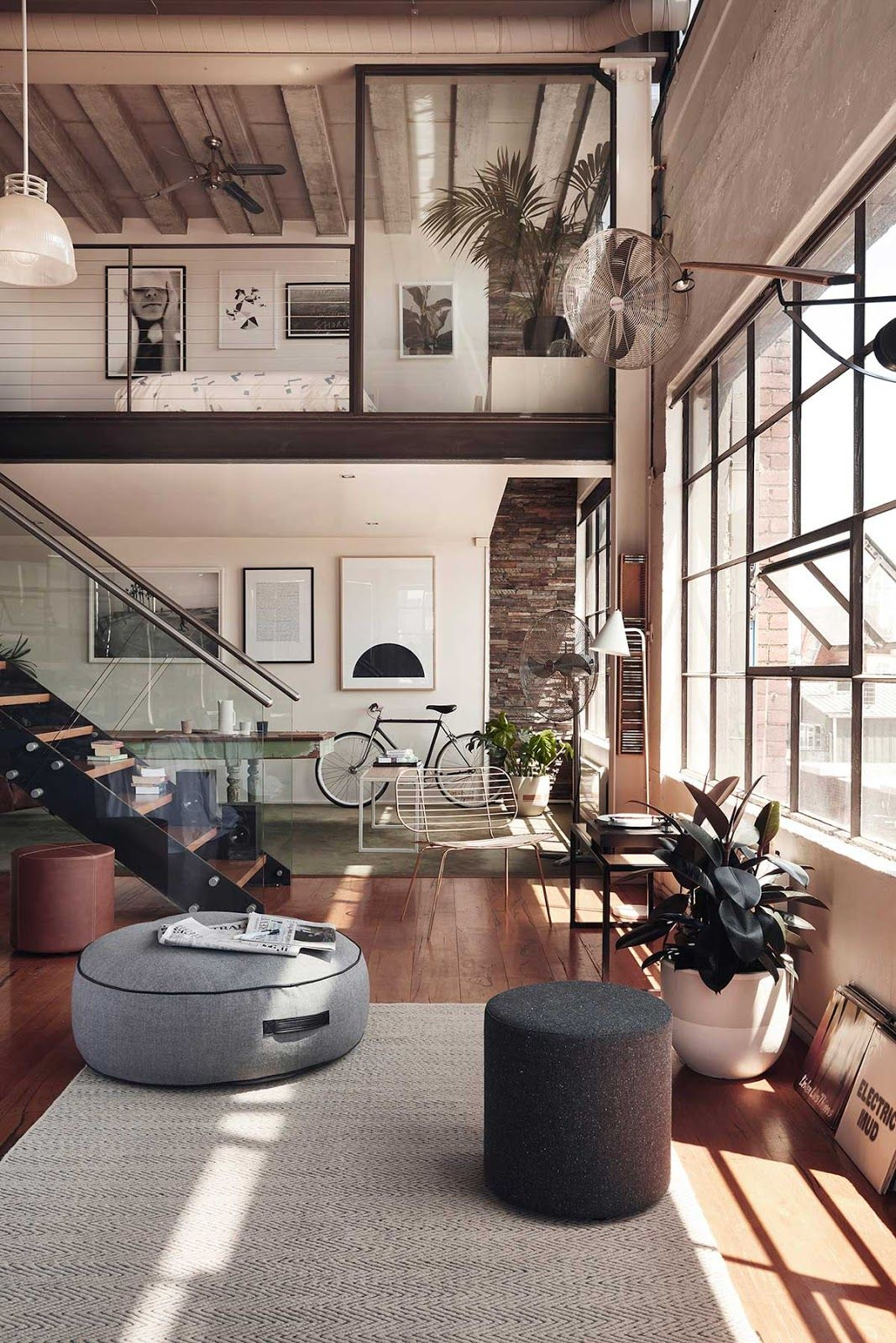 Love the soft and cozy vibe of the loft mixed with the industrial design the space is modern without sparring the