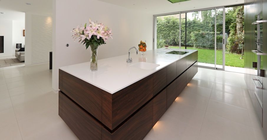 Kitchen designed in hand selected fumed Eucalyptus veneer ...