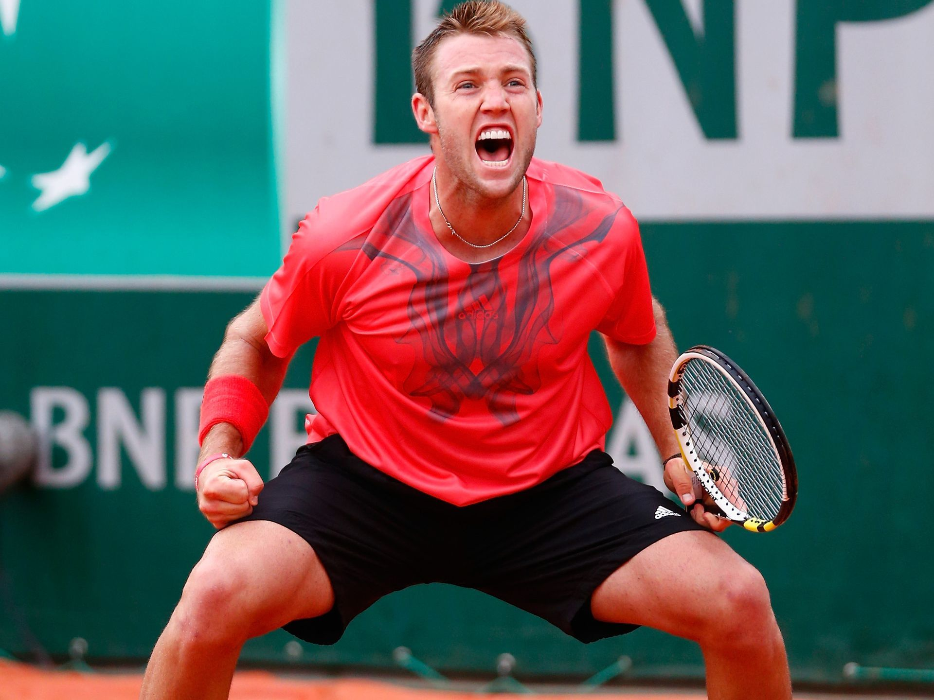 Jack Sock of the United States celebrates match point against Pablo Caerreno Busta.  Julian Finney, Getty Images