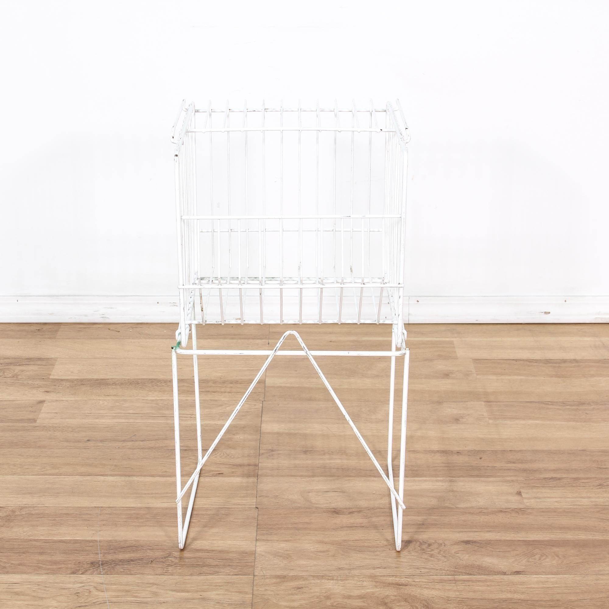 This magazine rack is featured in a white wire. This traditional ...