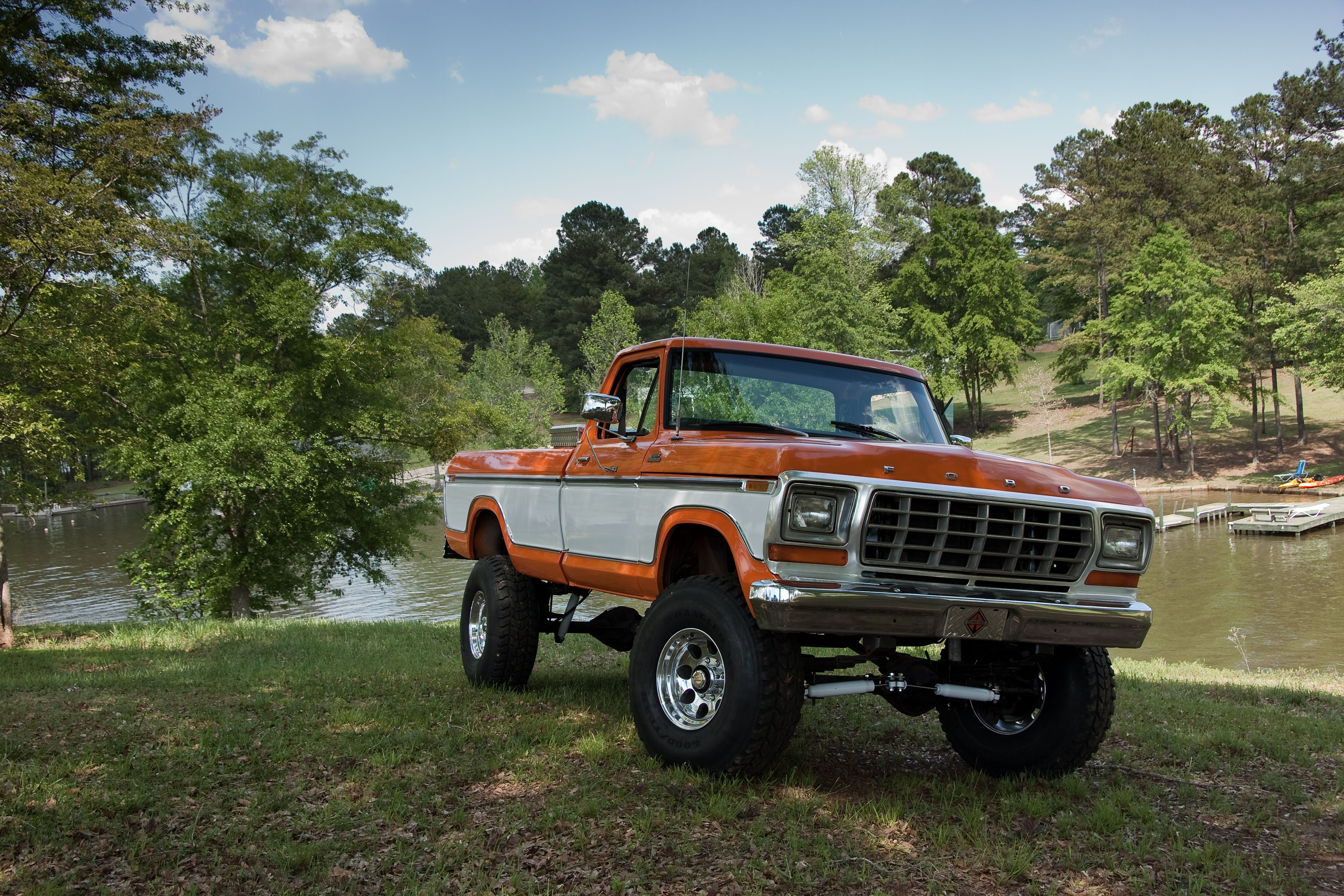 hight resolution of vintage jacked lifted orange white two tone lifted truck