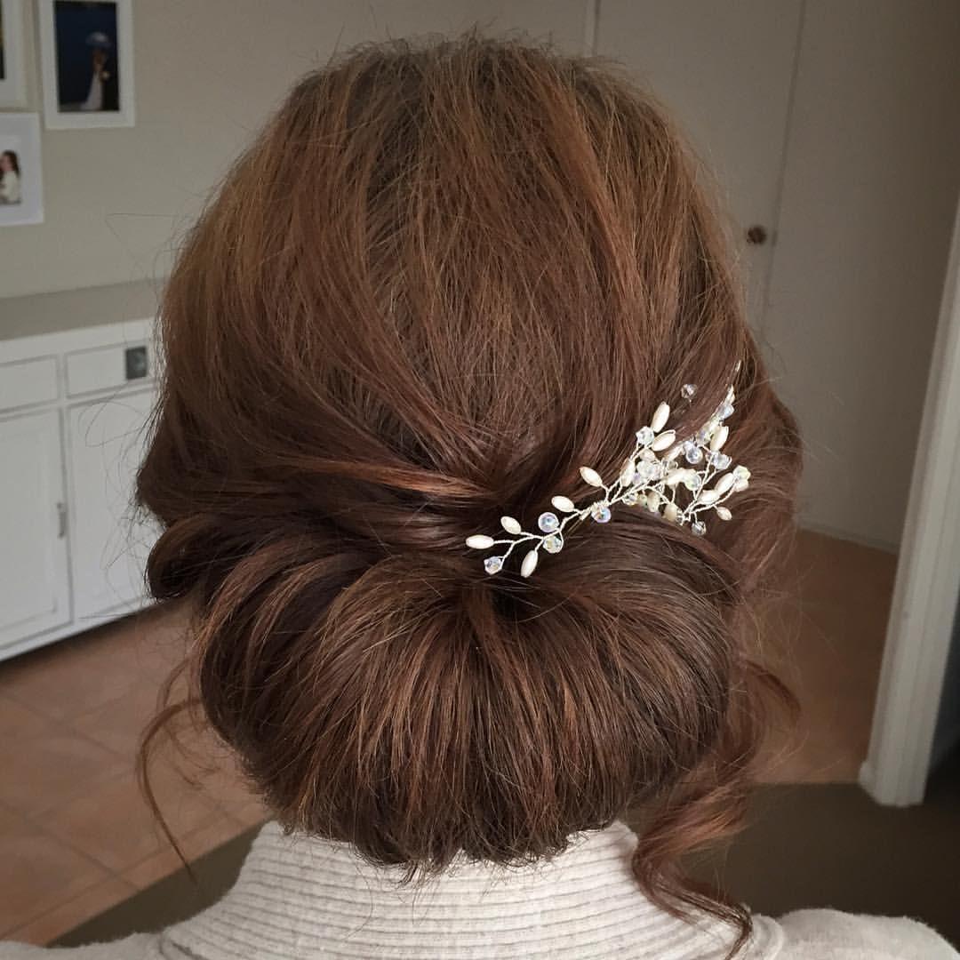 Low textured chignon with roslynharrisdesigns hair pins on Maddi