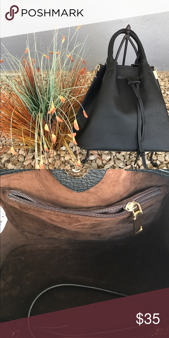 Black Bucket Bag Black vegan leather, brown suede interior. Two interior pockets, one with a zipper for security. Also comes with a removable shoulder strap and magnetic snap closure. Expands for easy entry. Bags Hobos